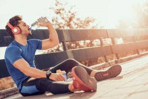 A man drinks water after a workout